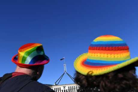 Marriage equality advocates are seen during the 'Sea of Hearts' event supporting Marriage Equality outside Parliament House in Canberra, Tuesday, August 8, 2017. (AAP Image/Lukas Coch) NO ARCHIVING