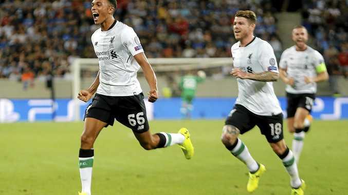 Liverpool's Trent Alexander-Arnold, left, celebrates scoring the opening goal against Hoffenheim.
