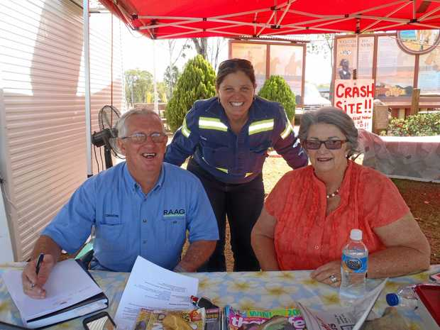ROAD SAFTEY: Graeme Ransley of RAAG with Fiona Kruger of Rio Tinto and Susie Whitehead working at Nebo Road Safe September.