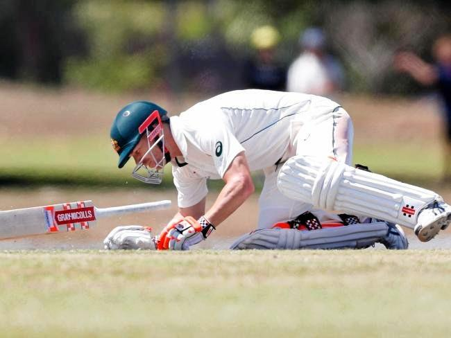 David Warner goes down after being hit by a Josh Hzleweood bouncer.