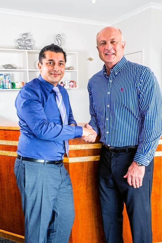 HANDOVER: Dr Greg Osborne (right) hands over the reins to new dentist Dr Monil Gohil.