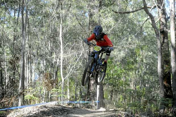AIRBORNE: Angus Baker hits a jump during stage one of the final round in the Under 15 National Gravity Enduro Series at Woodford Island.