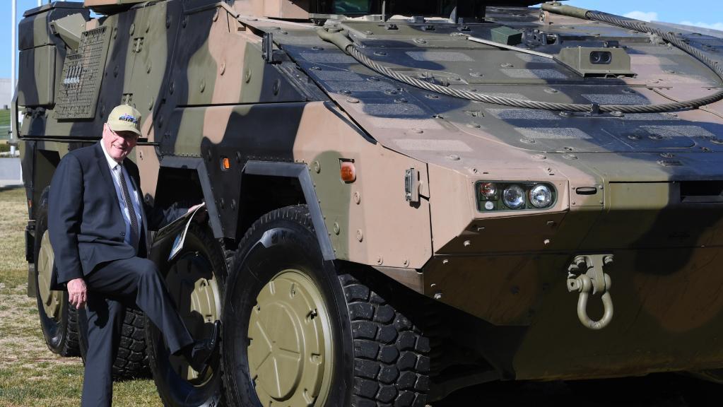 Queensland Senator Ian Macdonald with a Rheinmetall Boxer CRV.