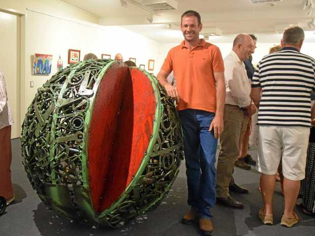 TOWN PRIDE: Chinchilla artist Dion Cross with his melon masterpiece which will be installed on Heeney St.