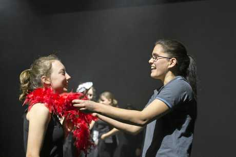 Highfields State Secondary College head of department and author of inaugural musical Sara Abawi (right) gets student Chloe Burton ready for the stage, Wednesday, August 16, 2017.