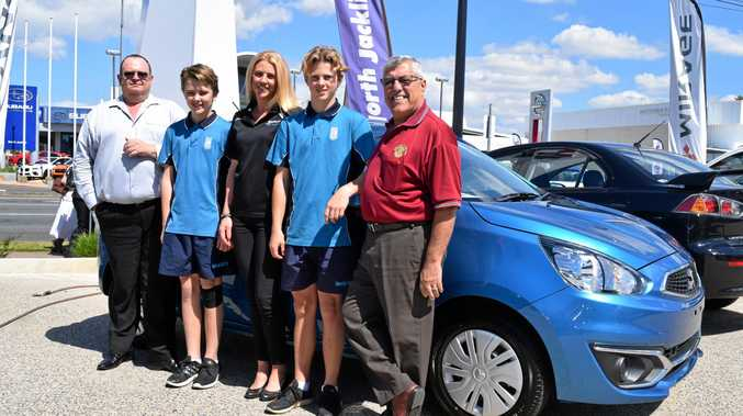 WINNERS: Julie Head with her sons Will and Luke are congratulated on winning their new Mitsubishi Mirage by North Jacklin principal dealer Joe Watson and Frank Caruana, of the Rotary Club of Mackay North.