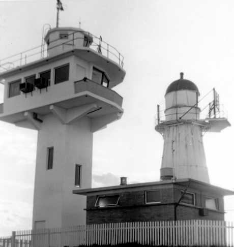 Original timber framed Caloundra lighthouse and the new Caloundra lighthouse and signal tower, 1969.