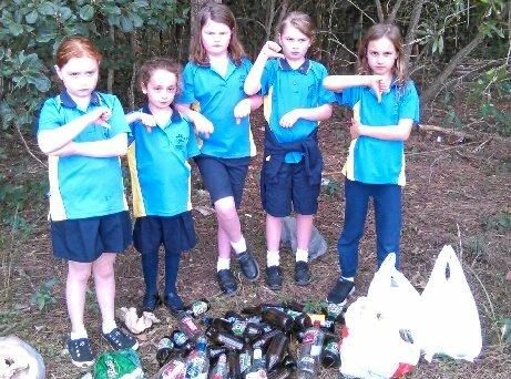 BAD HABITS: The Coffs Harbour Junior Guides were horrified at what they found during a bushland clean-up.