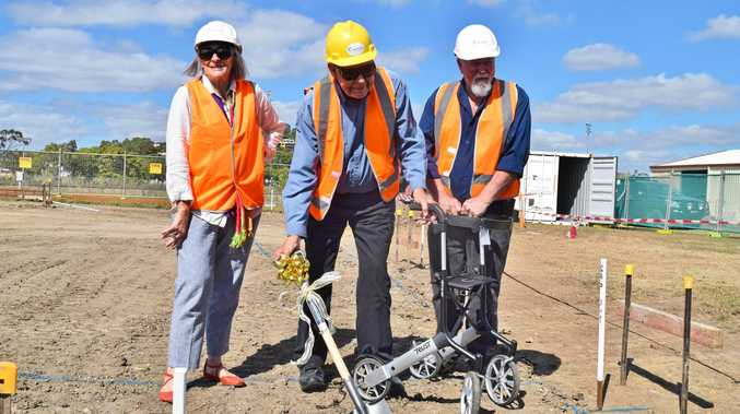 BEING BUILT: Kucom Theatre members Catherine Parr, John Tait and president Jim Kelly turn the first sod at site of the group's new centre at Snow Wright Ct, Andergrove.