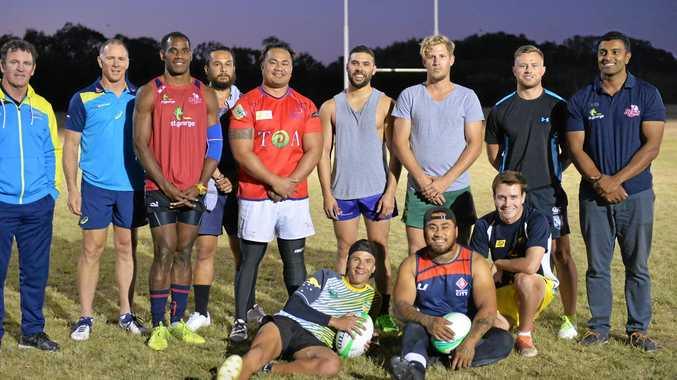 GEARING UP: The regional Queensland team at their final training session with former sevens coach Michael O'Connor, current coach Andy Friend and Queensland Reds' Rama Chand.
