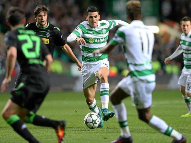 Celtic's Australian star Tom Rogic runs with the ball.