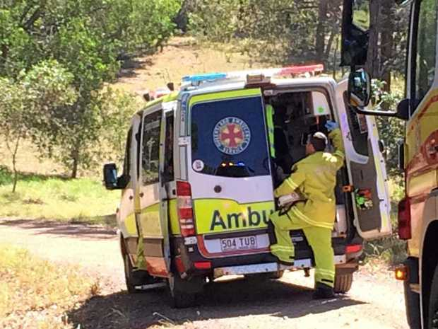 A woman has died after her car rolled down the hill of a private property at Veteran.