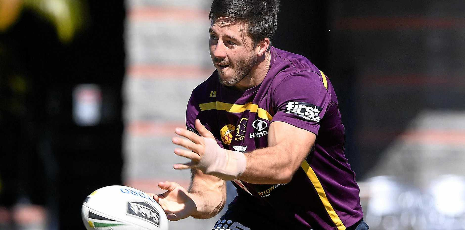 Ben Hunt - with his hand heavily bandaged - passes the ball during a Brisbane Broncos training session at Red Hill.