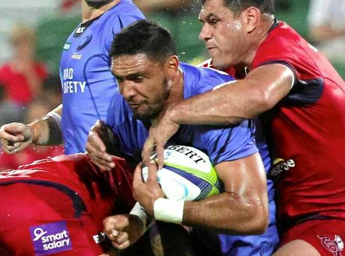 Curtis Rona is tackled while playing for the Western Force against the Queensland Reds.