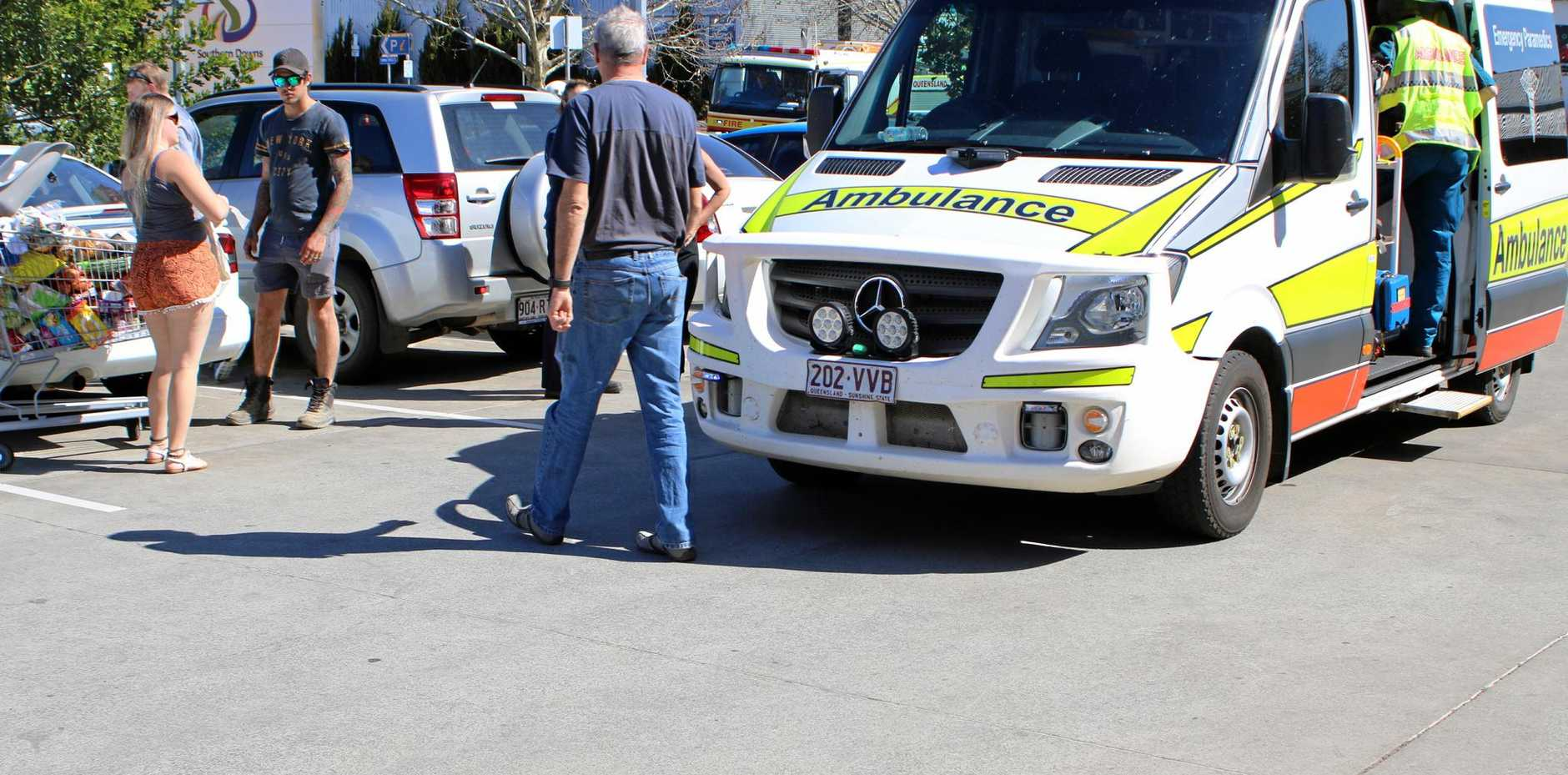 Paramedics treating a toddler reportedly hit by a car.
