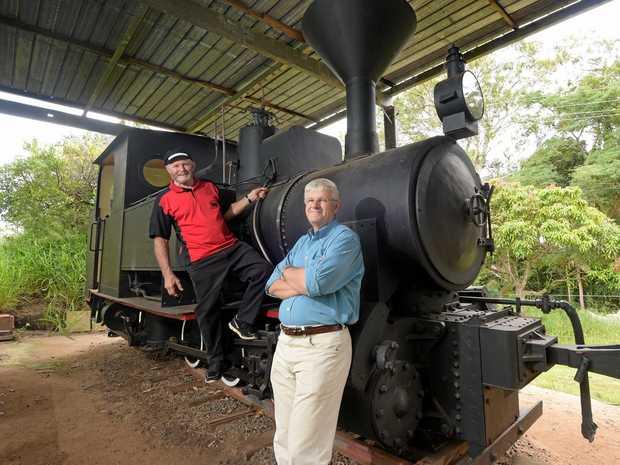 LONG JOURNEY: Buderim Palmwoods Heritage Tramway vice president Noel Williams (left) and Graham Barnes inspect the Krauss locomotive.