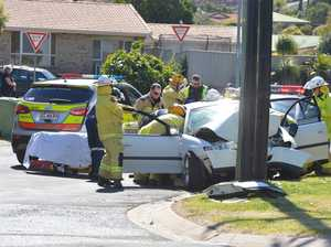 Car crash traps driver, brings down power line