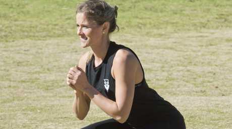 TSPT Toowoomba head trainer Sammy Thompson demonstrates a simple squat.