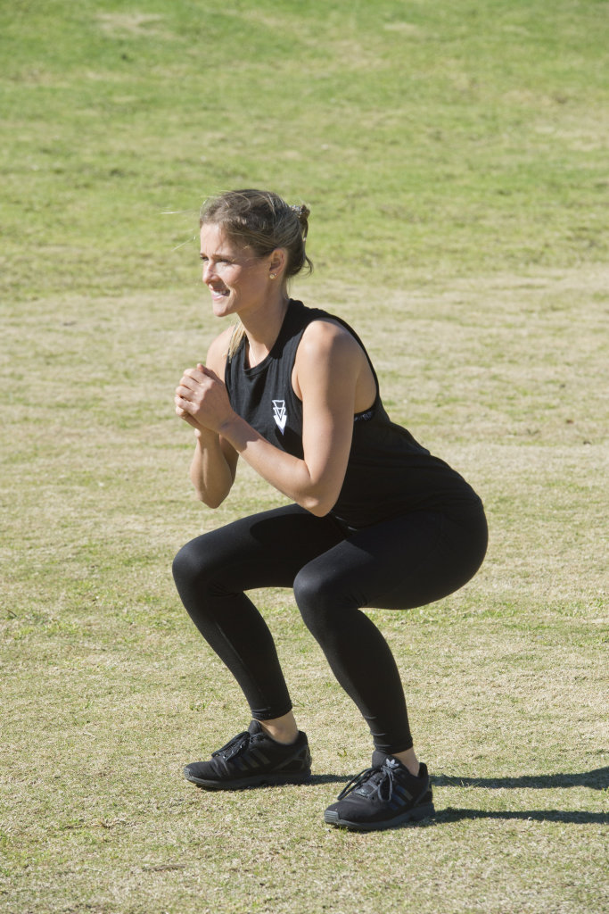 TSPT Toowoomba head trainer Sammy Thompson demonstrates a simple squat.