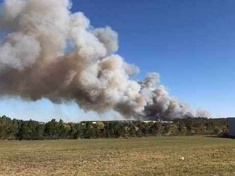 FIRE: A grassfire has been sparked next to the Bruce Hwy at Meridan Plains.