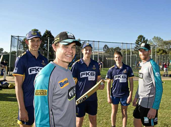 Queensland Bulls players Sam Heazlett (front) and Jason Floros chat to Toowoomba Grammar School First XI members (from left) Samson Ryan, Seb Ingold and Nick Brown yesterday.