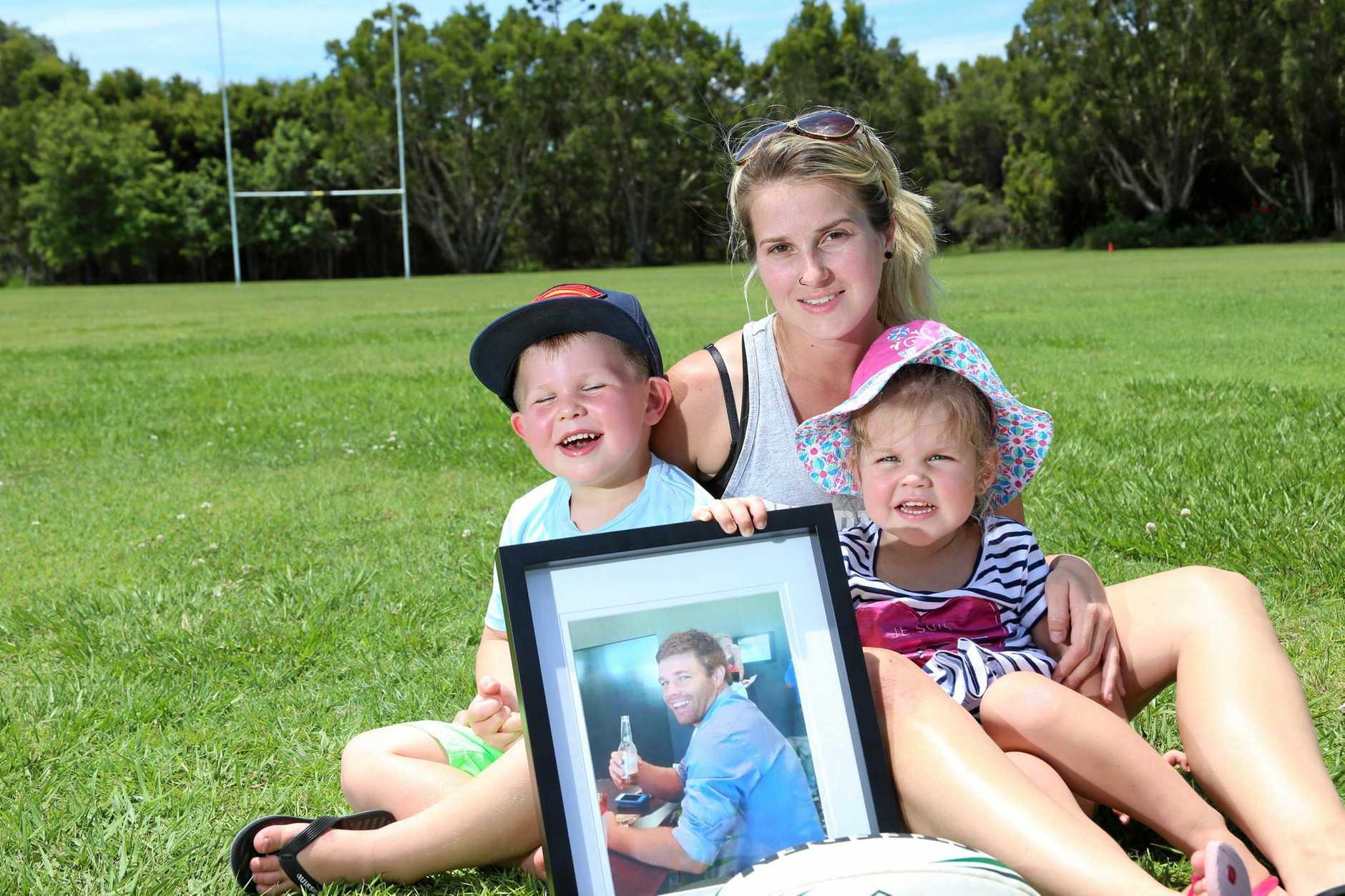 Saraa Ackerman, Ollie, 3, and Milly, 2, remember husband and father James Ackerman.   Photo Tessa Mapstone / Caloundra Weekly