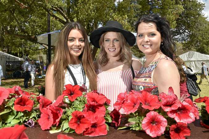 Carnival of Flowers 2014: Ergon Energy Food and Wine Festival, Queens Park. From left; Tayla Crotty, Tamika Freeman, Ally Burke.  Photo:  Bev Lacey / The Chronicle