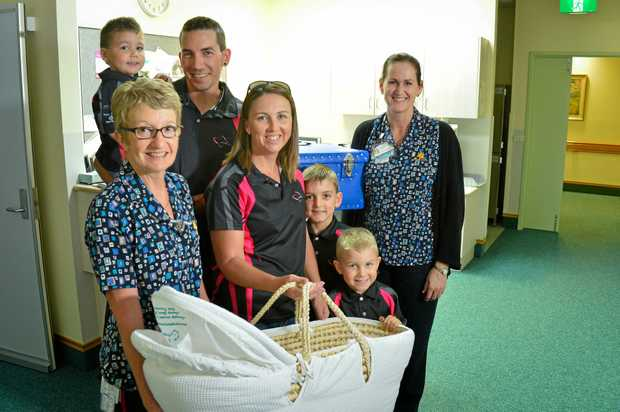 Monique, Jereme, Nate, 8, Kade, 6 and Ryder St Pierre, 3 presented the Gladstone Mater Hospitals midwife Kath Silverwood and nursing unit manager of wards and maternity Arlene Kirk with a $6000 cuddle cot this week.