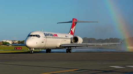 Qantas arrives at Sunshine Coast Airport to a water-cannon celebration.