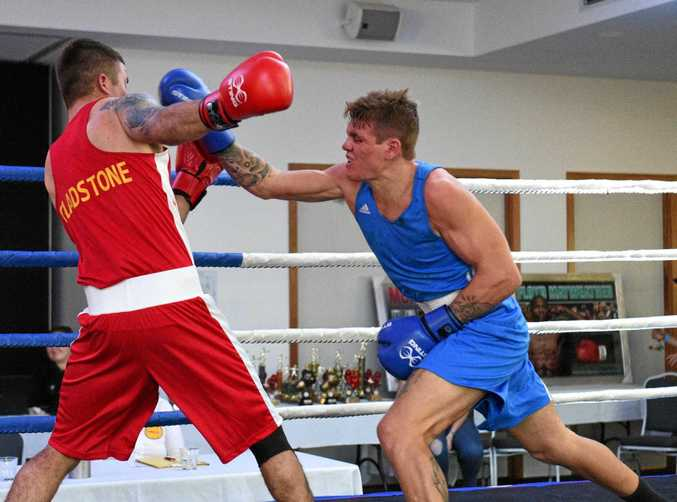 CONTENDER: Billy Hatton, right, in a recent fight against Gladstone's Nathan Street at Hervey Bay.
