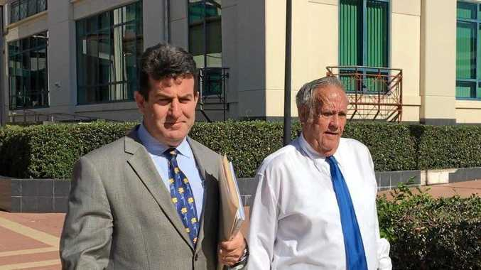 Defence lawyer Brian McGowran and accused child sex offender Kevin Leslie Baker leave Rockhampton Magistrates Court.