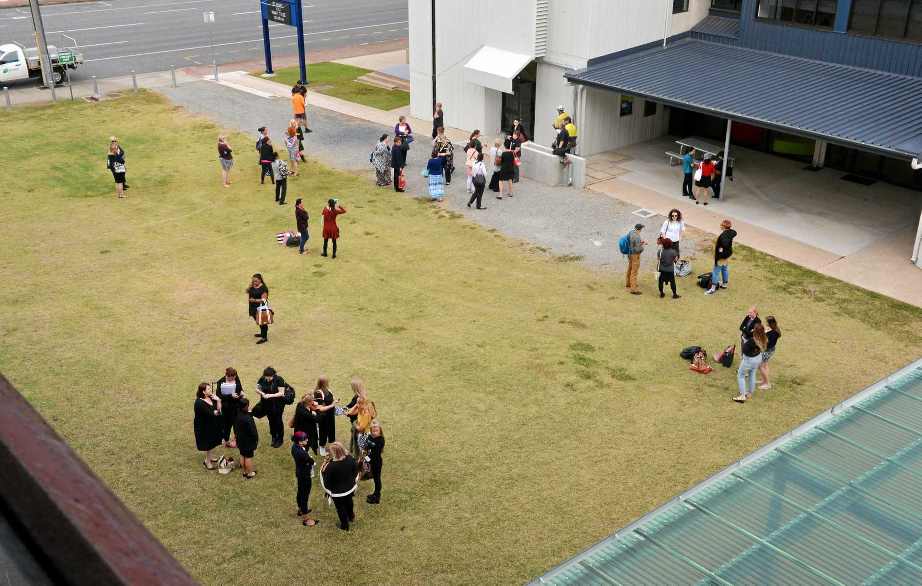 Students and staff evacuated at the CQ University city campus following the earthquake.