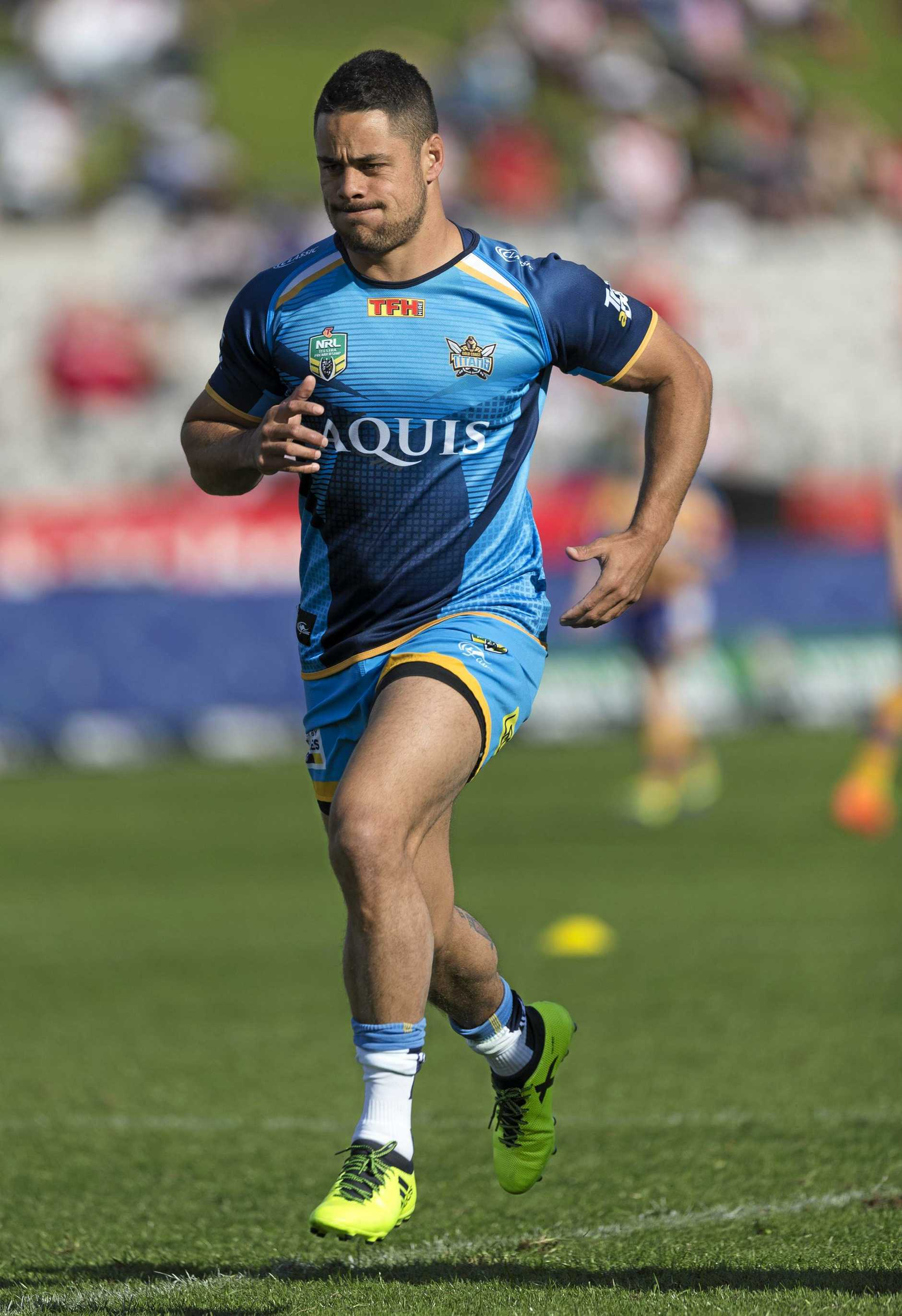 Jarryd Hayne of the Titans warms up before the round 23 clash with the Dragons.