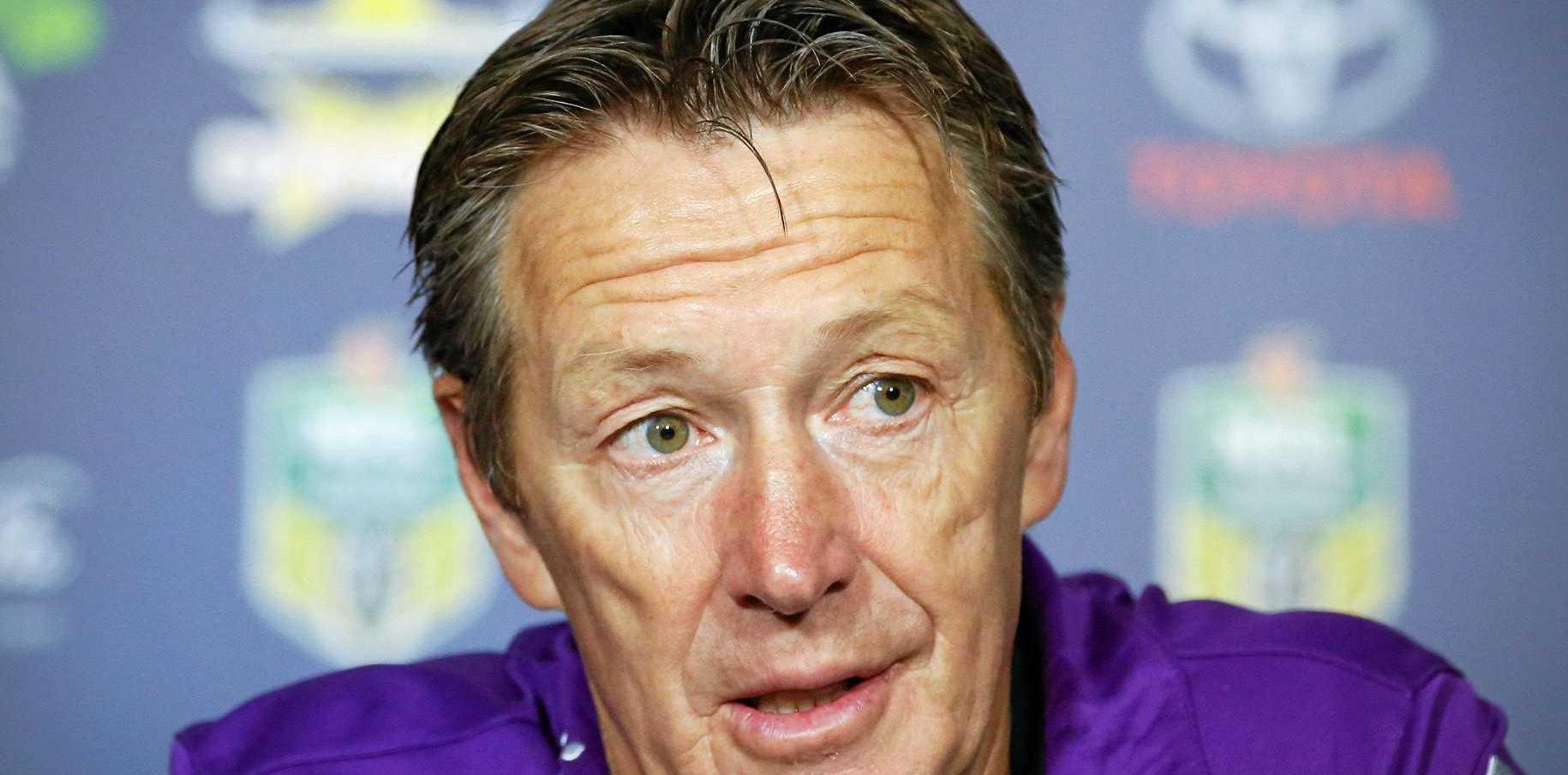 Melbourne Storm coach Craig Bellamy talks at a post-game media conference.