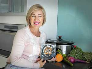 Kim McCosker with one of her 30 cookbooks, The Easiest Slow Cooker Book Ever.