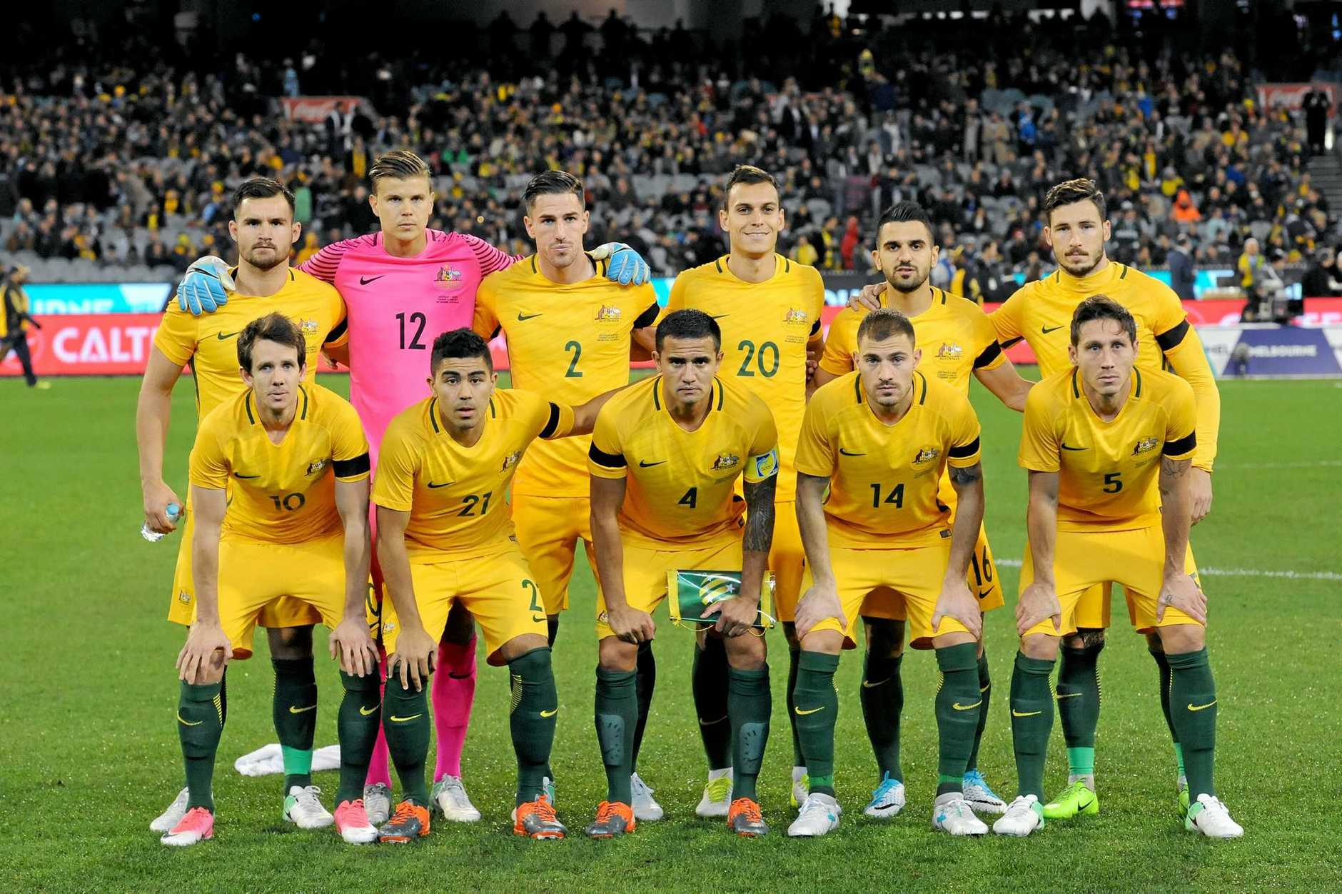 Australian players line up for the team photo during an international friendly between Australia and Brazil, at the MCG in Melbourne, Tuesday, June 13, 2017.(AAP Image/Joe Castro) NO ARCHIVING, EDITORIAL USE ONLY