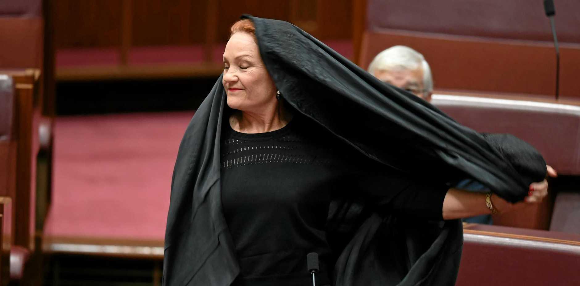 STUNT? One Nation senator Pauline Hanson removes the burqa.