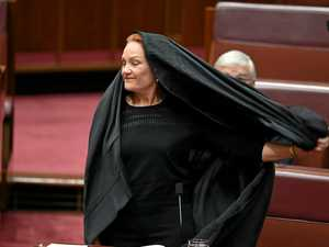 STUNT? One Nation senator Pauline Hanson removes the burqa.