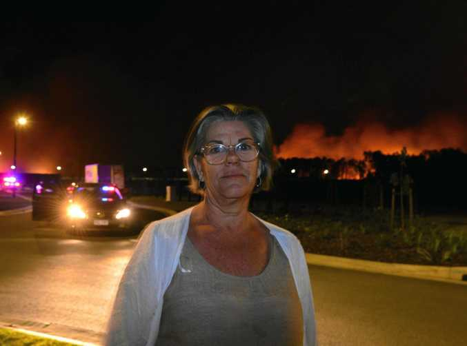 A fire threatens Aura and Bells Reach. Resident of Aura Pru Schalkwyk was very worried.
