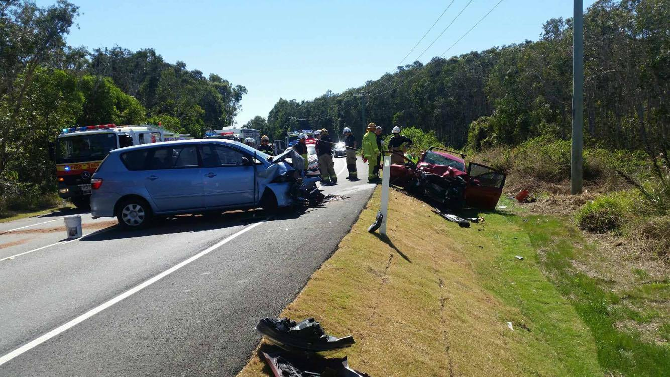 Two cars have collided in a crash on David Low Way that has closed the major road in both directions.