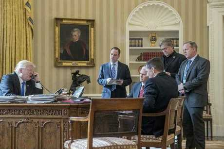 In this Jan. 28, 2017 file photo, President Donald Trump, accompanied by from second from left, Chief of Staff Reince Priebus, Vice President Mike Pence, National Security Adviser Michael Flynn, Senior Adviser Steve Bannon, and White House press secretary Sean Spicer, speaks on the phone with Russian President Vladimir Putin. Only Pence and Trump remain in the White House. Photo: AP