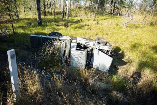 The car rolled over after coming off the side of the Bruce Hwy north of Gympie this morning.