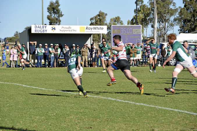 Centre Matt Lyons opens up the Condamine defence on his way to scoring a match-clinching try in today's Risdon Cup elimination semi-final at John Ritter Oval.