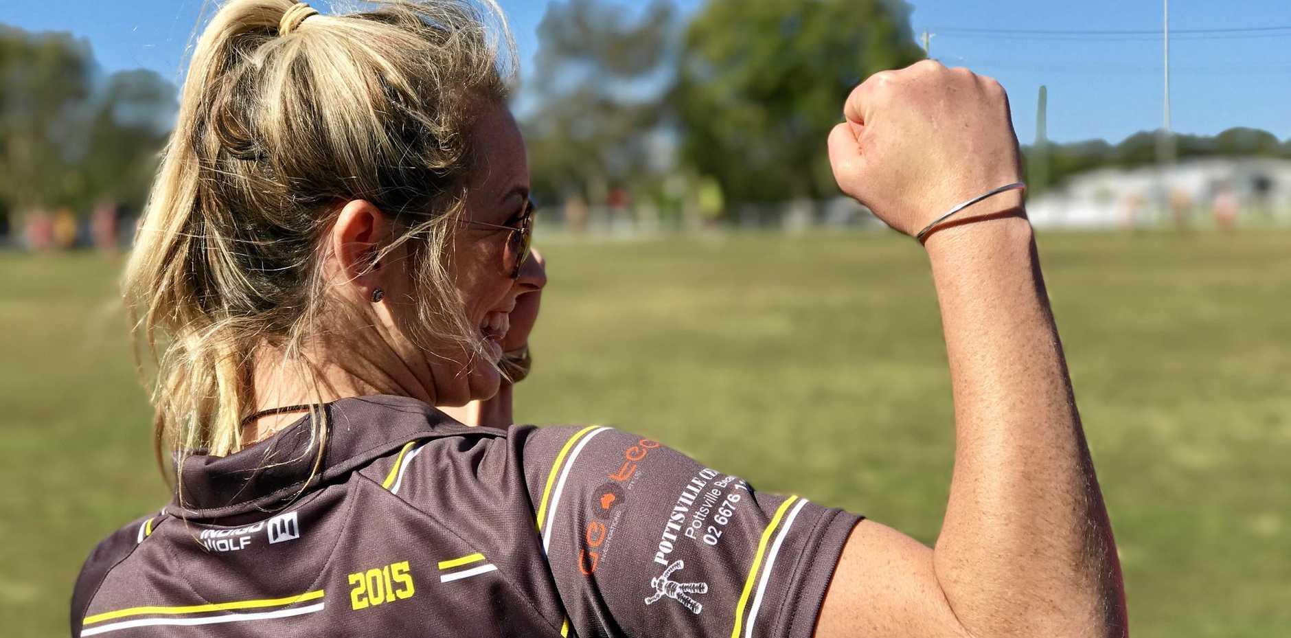 TIGER POWER: Tweed Coast Tigers women's coach Katie Patison celebrates her team's first win.