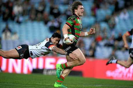 Angus Crichton of the Rabbitohs is tackled by Issac Luke of the Warriors.