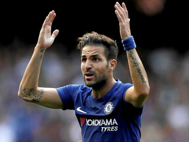 Chelsea's Cesc Fabregas reacts after getting a red card against Burnley.