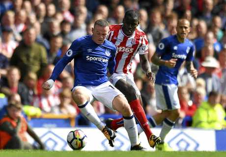 Everton's Wayne Rooney and Stoke City's Kurt Zouma.
