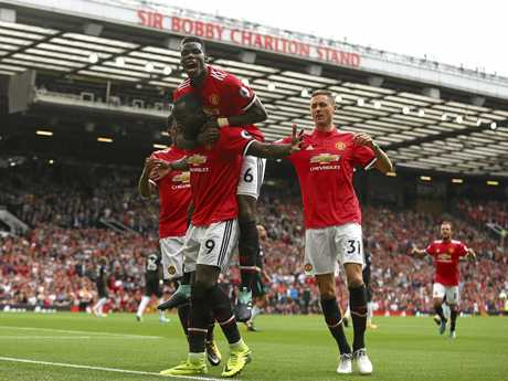 Manchester United's Romelu Lukaku celebrates scoring his side's second goal against West Ham with Paul Pogba (top) and Nemanja Matic (right).
