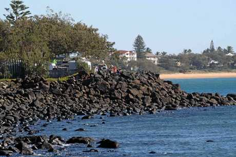 Onlookers seek to catch a glimpse of the whales at Bargara.