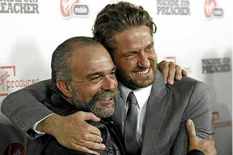 Sam Childers, pictured with actor Gerard Butler, who played the assault rifle-wielding crusader in the 2011 movie.